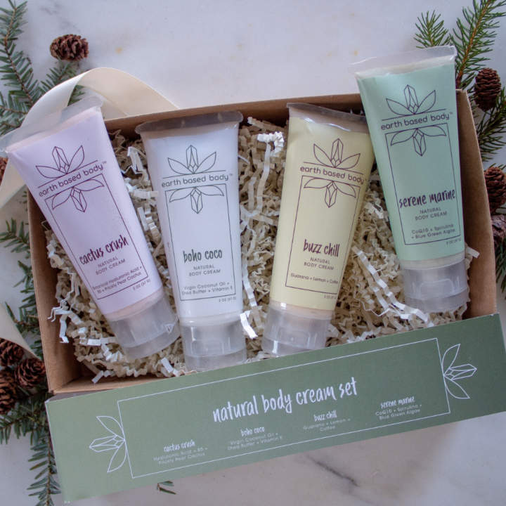 Natural body Cream Minis bursting out of gift box